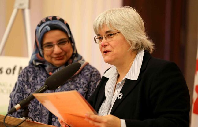 Shahina Siddiqui (left), chair of Islamic History Month Canada, listens as Immigration and Multiculturalism Minister Christine Melnick reads a proclamation recognizing October as Islamic History Month Wednesday evening.