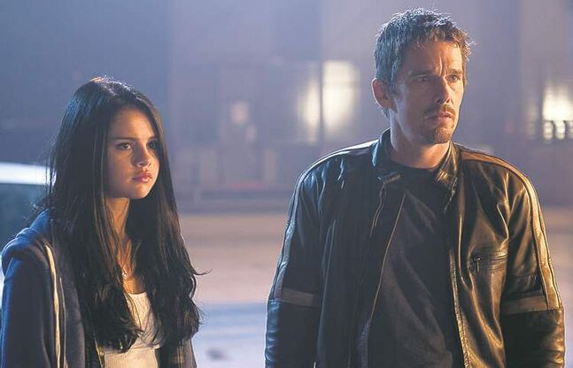 Girl's got drive: Multi-tasker Selena Gomez, left, and Ethan Hawke star in Getaway.