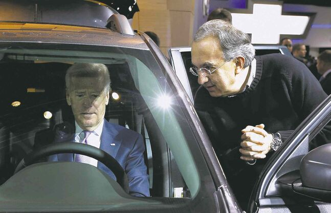 Vice President Joe Biden sits in a Chrysler product and listens to Chrysler-Fiat CEO Sergio Marchionne at the North American International Auto in Detroit. Biden said the U.S. auto industry's resurgence since the 2009 federal bailout provides a strong basis for a Motor City recovery.