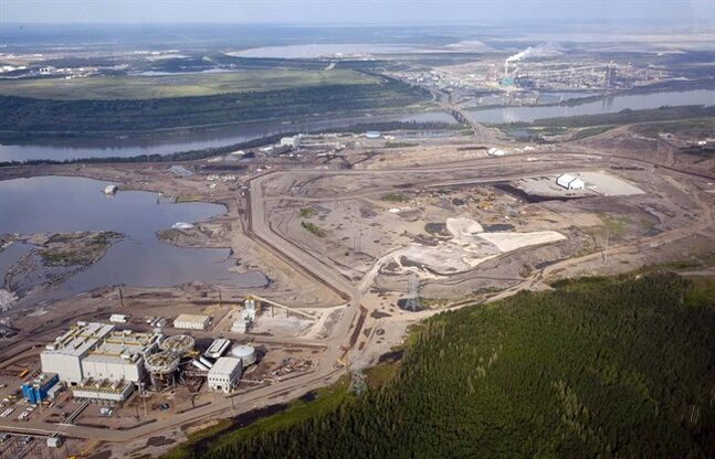 The Athabasca river runs through a Suncor oilsands facility near Fort McMurray, July 10, 2012.THE CANADIAN PRESS/Jeff McIntosh