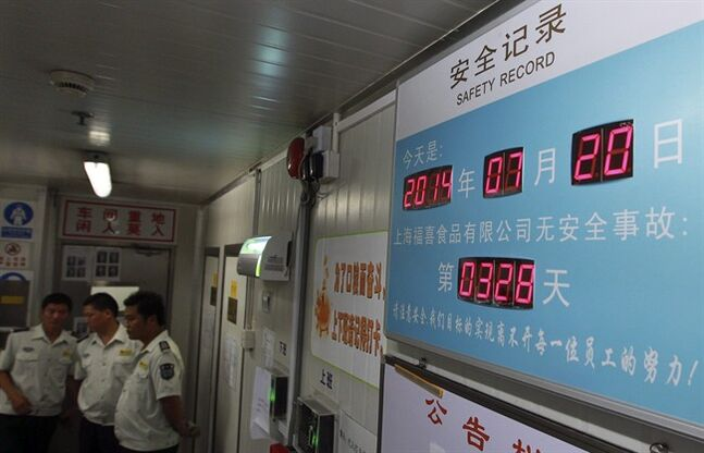 In this July 20, 2014 photo released by China's Xinhua News Agency, an electronic screen shows the safety record at Husi Food Co. in Shanghai, China, a meat supplier for McDonald's and KFC owned by OSI Group, a privately-held company that's based in Aurora, Ill. OSI was thrust into the spotlight this weekend when a Chinese TV station reported the Husi plant repackaged old beef and chicken and slapped new expiration dates on them. (AP Photo/Xinhua, Pei Xin) NO SALES