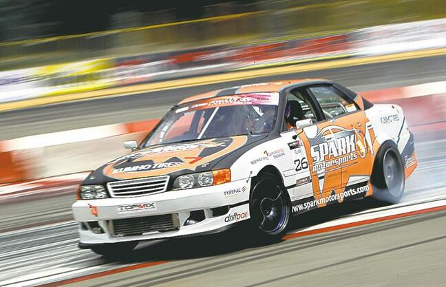 Ken Gushi of the United States performs during a drifting demonstration at the Singapore Formula One track.