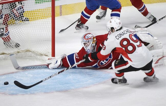 Ottawa Senators' Cory Conacher scores against Montreal Canadiens' goaltender Peter Budaj during the first period, putting the Senators up 2-0.