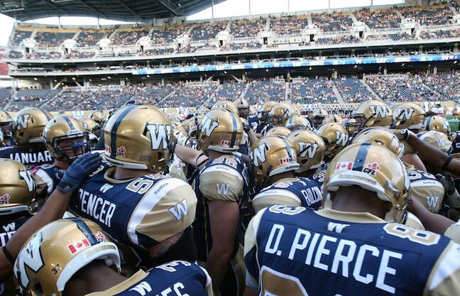 The Bombers get fired up before opening kickoff.