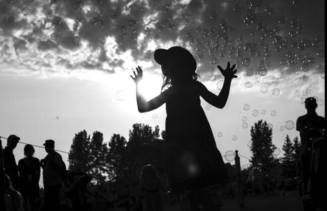 A girl enjoys the Winnipeg Folk Festival at Birds Hill Park on Wednesday's opening night.