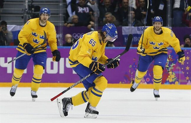 Sweden defenseman Erik Karlsson reacts after scoring a goal against Finland during the second period of a men's semifinal ice hockey game at the 2014 Winter Olympics, Friday, Feb. 21, 2014, in Sochi, Russia. (AP Photo/Petr David Josek)