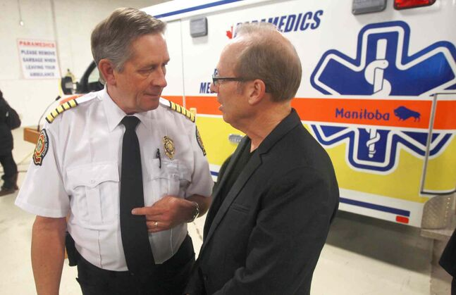 Fire-paramedic Chief Reid Douglas and Mayor Sam Katz chat earlier this year. Now, Katz isn't saying why Douglas is gone.
