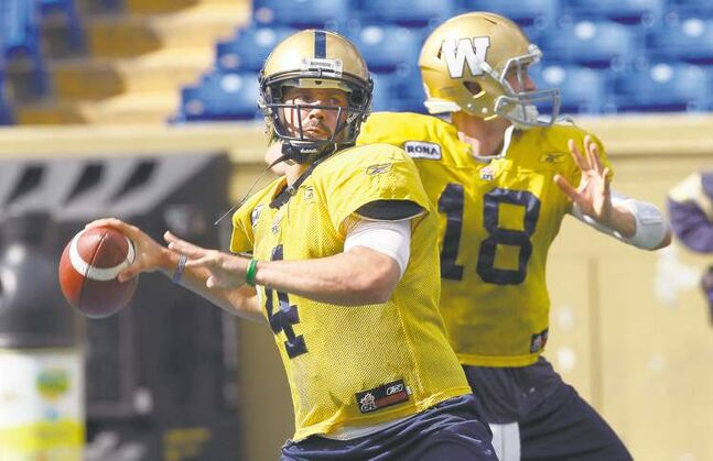 Injured Bombers quarterback Buck Pierce (left) chucks balls with third-string QB Justin Goltz during a practice at Canad Inns Stadium on Wednesday.