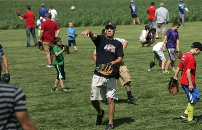 Tom Stahl, 66, of Dublin, Ohio, has a catch with his 32-year-old son, Josh Stahl of Portland, Ore., on Saturday, June 14, 2014,at the Field of Dreams 25th anniversary celebration, Saturday, June 14, 2014, on the Field of Dreams outside Dyersville, Iowa. (AP Photo/Waterloo Courier,Dennis Magee)