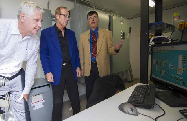 From left, Gord Mackintosh, Sam Katz and Irvin Slike take a tour following an announcement of the completion of the methane gas collection system at Brady Road.
