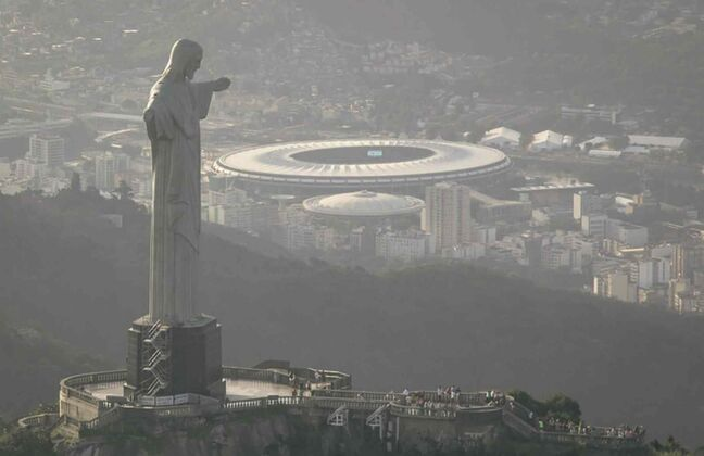 This aerial view shot through an airplane window shows the Maracana stadium behind the Christ the Redeemer statue in Rio de Janeiro, Brazil, Tuesday, May 13, 2014. As opening day for the World Cup approaches, people continue to stage protests, some about the billions of dollars spent on the World Cup at a time of social hardship, but soccer is still a unifying force. The international soccer tournament will be the first in the South American nation since 1950.