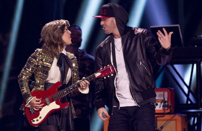 Serena Ryder and Classified perform during the Juno Awards in Winnipeg, Sunday, March 30, 2014.