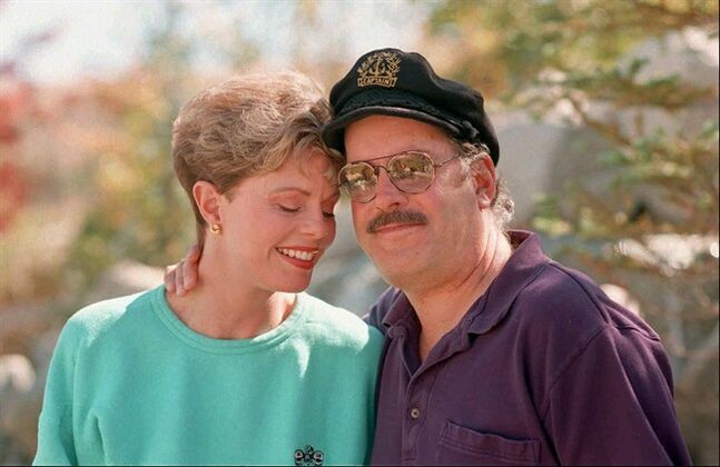 File-This Oct. 25, 1995 file photo shows Toni Tennille, left, and Daryl Dragon, the singing duo The Captain and Tennille, posing during an interview in at their home in Washoe Valley, south of Reno, Nevada. Court documents filed by Tennille in Arizona say that her marriage to Dragon is irretrievably broken and cannot be reconciled. The two have been married for more than 38 years. The popular 1970s pop duo's hits include