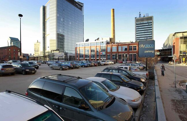 A surface parking lot south of Graham Avenue between Hargrave Street and Carlton Street for City Place.
