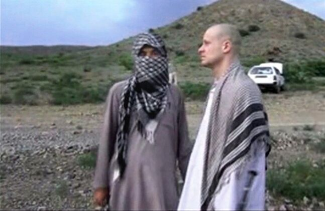 FILE - In this file image taken from video obtained from Voice Of Jihad Website, which has been authenticated based on its contents and other AP reporting, Sgt. Bowe Bergdahl, right, stands with a Taliban fighter in eastern Afghanistan. The Taliban said Friday, June 6, 2014, that Bergdahl was treated well during the five years they held him captive and was even allowed to play soccer with the men holding him. (AP Photo/Voice Of Jihad Website via AP video, File)