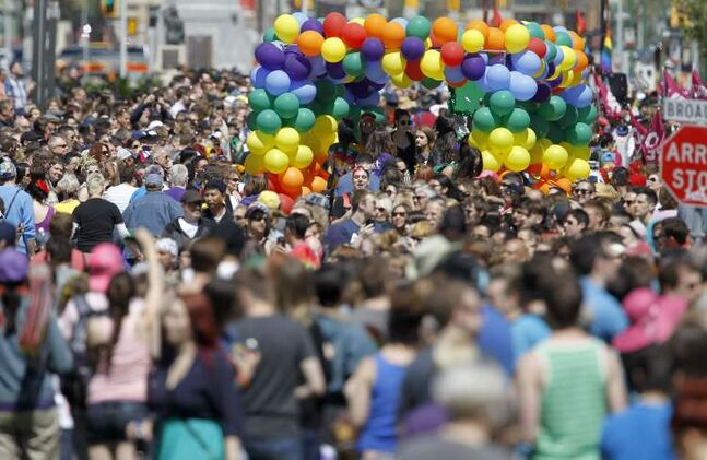 The 26th annual Pride Parade makes its way through downtown Winnipeg to the Manitoba Legislative Building on Sunday.