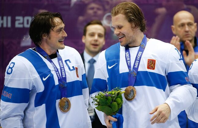 Former Winnipeg Jet Teemu Selanne and current Jet Olli Jokinen celebrate with their medals after the men's bronze medal hockey game Saturday. Finland defeated the United States 5-0 in the game.