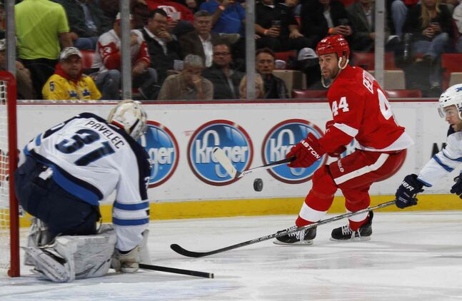 Detroit Red Wings forward Todd Bertuzzi puts a shot on Winnipeg Jets goalie Ondrej Pavelec in the first period.