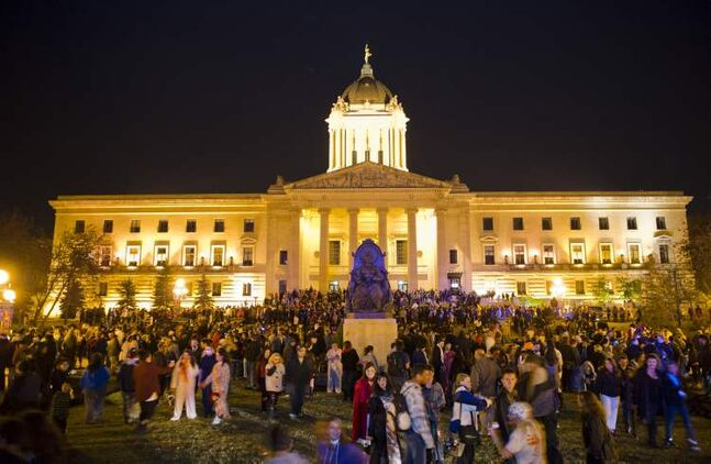 Thousands of people completed the the annual Winnipeg Zombie Walk from The Forks to The Manitoba Legislative Building Saturday night. 