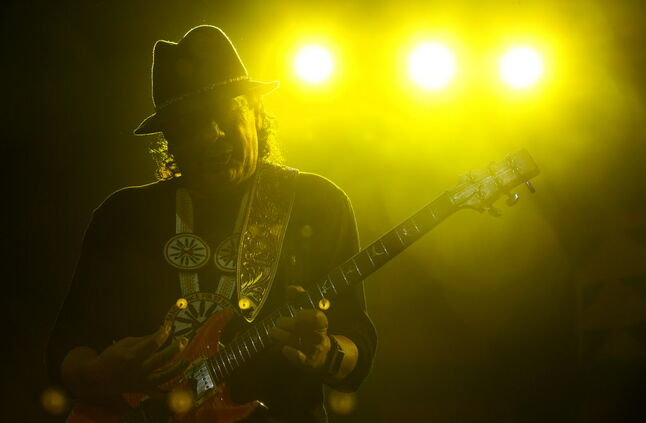 Carlos Santana performs before Rod Stewart at MTS Centre in Winnipeg, Friday.