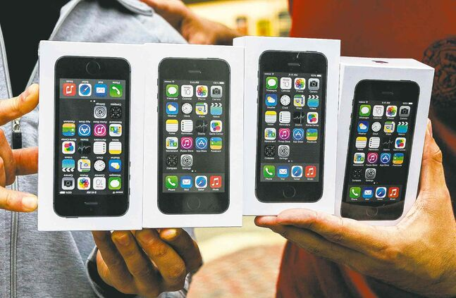 The new iPhones were snapped up by thousands the first day the Apple product went on sale.