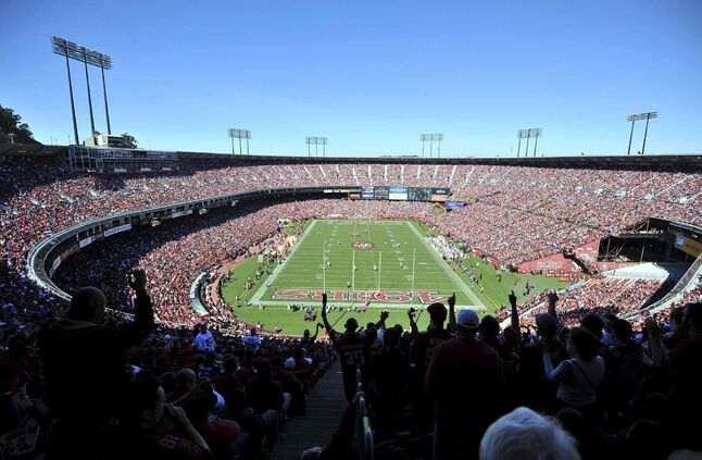This Oct. 14, 2012 file photo shows fans cheering at Candlestick Park during the first half of an NFL football game between the San Francisco 49ers and the New York Giants.