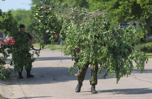 Soldiers with the 1 Royal Canadian Horse Artillery help remove debris at CFB Shilo on Friday morning after a severe thunderstorm with high winds hit the area Thursday.