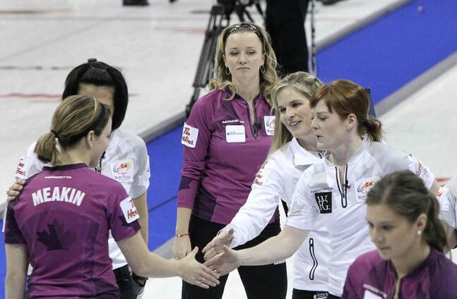 Jennifer Jones' and Chelsea Carey's teams shake hands after the Jones rink triumphed 10-2.