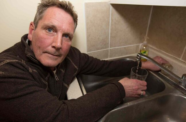 Todd Kerr's water pipes were frozen for 17 days before they thawed on their own. He wants to keep the tap running so they won't refreeze, but the city says it'll cost him.