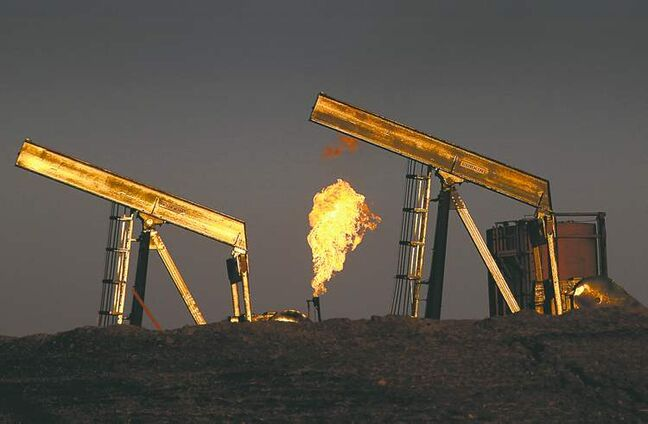 Excess gas is burned off at well sites east of Williston, N.D. BNSF is crucial in the Bakken oil boom.