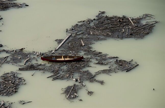 A aerial view shows the damage caused by a tailings pond breach on Lake Polley, B.C. Tuesday, August, 5, 2014. THE CANADIAN PRESS/Jonathan Hayward