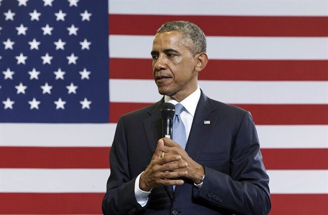 President Barack Obama speaks at the Walker Jones Education Campus in Washington, Monday, July 21, 2014. The drums of impeachment grew louder this week and, wouldn't you know it, the loudest thumping emanated from inside the White House. THE CANADIAN PRESS/AP/J. Scott Applewhite