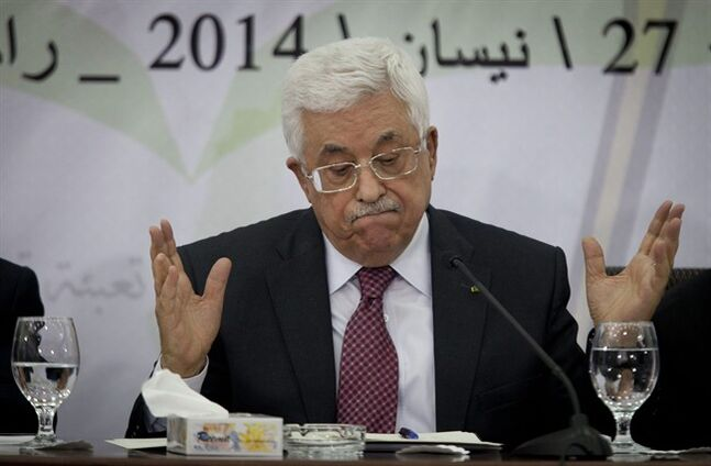 FILE - Palestinian President Mahmoud Abbas speaks during a meeting with the Palestinian Central Council, a top decision-making body, at his headquarters in the West Bank city of Ramallah, in this April 26, 2014 file photo. Abbas has called the Holocaust