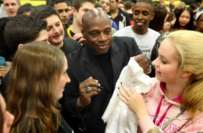 Coach Ken Carter is surrounded by hundreds of high school students from Dakota Collegiate Institute for pictures and autographs after he spoke to them on the importance of education this morning.