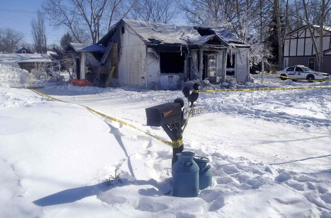 A house fire early Tuesday claimed the life of a senior and left her husband in hospital with serious burns.