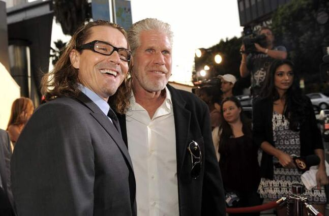 'Sons of Anarchy' cast member Ron Perlman (right) with creator and executive producer Kurt Sutter before a screening of the fourth season premiere of the television series in 2011.