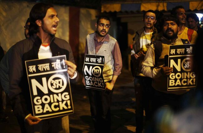 Indian gay rights activists hold placards and shout slogans in January against a recent Supreme Court verdict that upheld section 377 of the Indian Penal Code that criminalizes homosexuality in New Delhi, India.