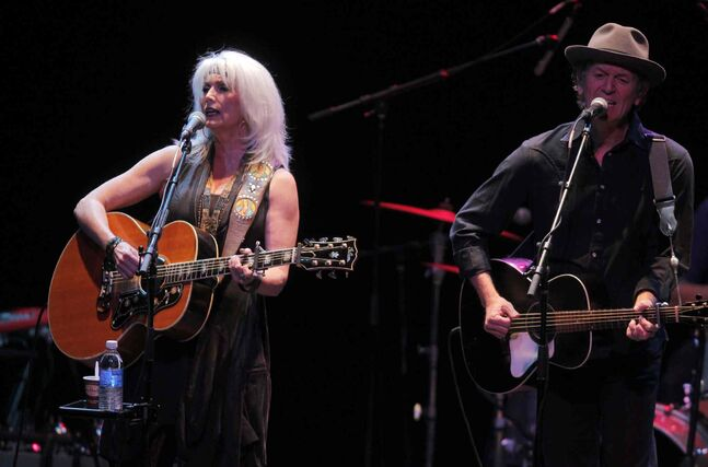 Singer-songwriters Emmylou Harris (left) and Rodney Crowell perform at the Burton Cummings Theatre Thursday night.