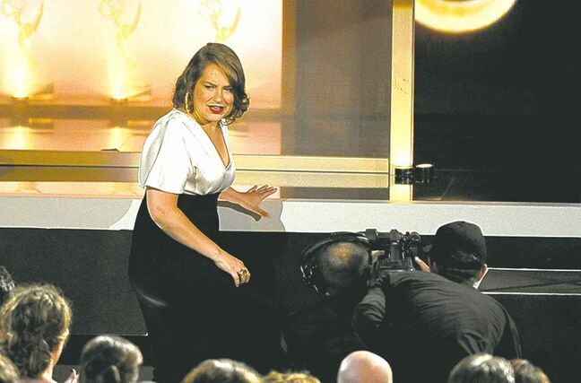 A shocked Merritt Wever approaches the stage to accept her Emmy Sunday night.