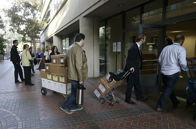 Boxes containing documents related to the Apple Inc. v. Samsung case are taken into a federal courthouse in San Jose, Calif., Tuesday, April 29, 2014. Lawyers for both companies are expected to deliver closing arguments Tuesday before jurors are sent behind closed doors to determine a verdict in a closely watched trial over the ownership of smartphone technology. (AP Photo/Jeff Chiu)