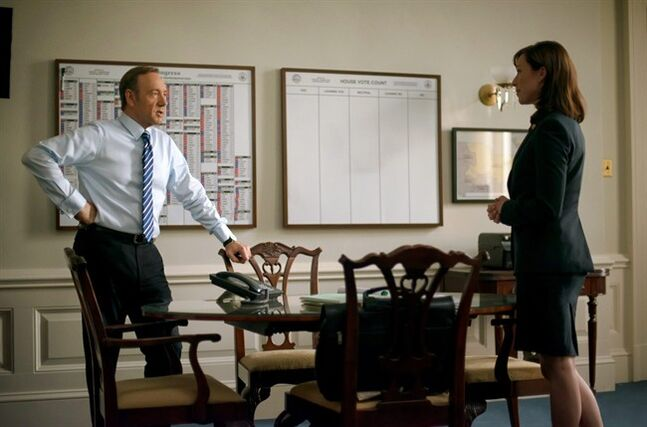 This image released by Netflix shows Kevin Spacey, left, and Molly Parker in a scene from