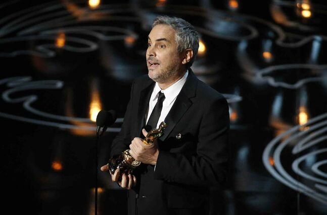 Alfonso Cuaron accepts the Academy Award for best director.