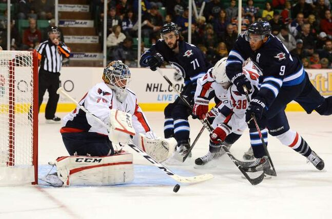 Capitals' goalie Braden Holtby stops a shot from the Jets' Evander Kane during pre-season NHL hockey action on Saturday.