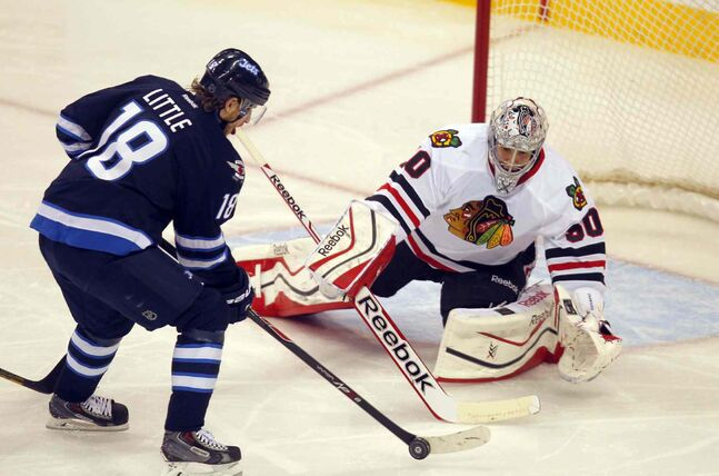 Bryan Little gets in close on Blackhawks goalie Corey Crawford during the first period.