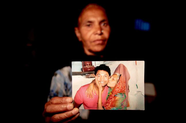 Fatima Munshi, Saroo Brierley's mother, holds up a photo from their February 2012 reunion at her home in India.