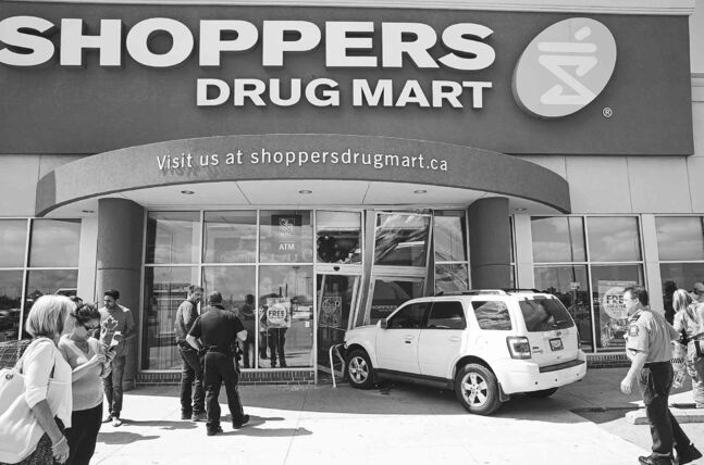 Melissa Tait / Winnipeg Free Press An SUV drove through the front doors of a Shoppers Drug Mart near the corner of Leila and McPhillips around 2:45 p.m. Wednesday. No one was seriously injured.
