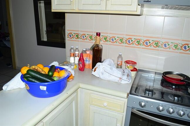 Food and drinks sit on a kitchen countertop in a high-rise condominium where famed drug boss Joaquin Guzman Loera
