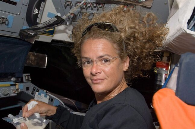 Canadian Space Agency astronaut Julie Payette, STS-127 mission specialist, eats a meal on Space Shuttle Endeavor's flight deck during flight day 3, on Friday July 17, 2009. Five years after her final flight, retired astronaut Payette admits she had doubts she would ever fly as she watched the Americans send astronauts to the moon in the late 1960s and early '70s. THE CANADIAN PRESS/HO, NASA Photo