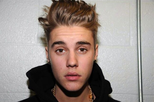 Justin Bieber is pictured at the police station in Miami Beach, Fla. on Jan. 23, 2014. A hearing is scheduled Tuesday to determine whether Justin Bieber will be tried on charges of driving under the influence and resisting arrest. THE CANADIAN PRESS/AP, HO, Miami Beach Police Dept.