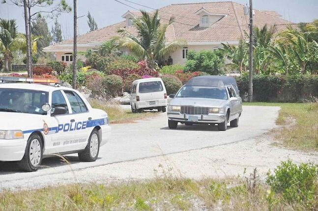 A hearse takes the body of Edgar Dart to the morgue on Grand Bahama.